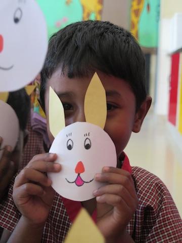 En gutt på YWCA, som er en førskole for barn som bor i slummen.